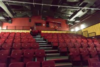 an interior image of junction from the stage, showing red raked seating