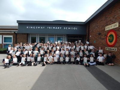 Kingsway Primary School pupils holding their Arts Award certificates.