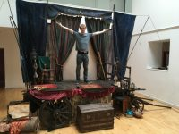 Behind the scenes of the set for Wonders Wonders Wonders showing a travelling showman's wagon.