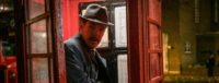 Still from film: Greville Wynne (Benedict Cumberbatch) emerging from an old fashioned red telephone box